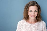 woman headshot blue background